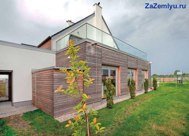 Деревянный дом с участком земли